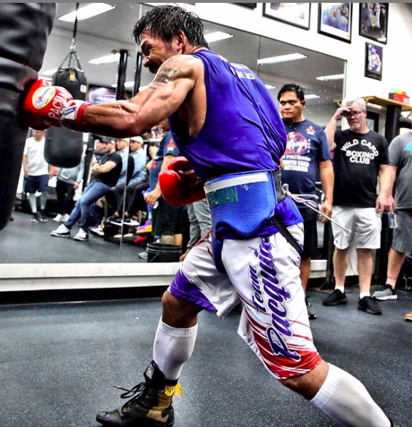 Manny Pacquiao punches a heavy bag, while prepping for his Jan. 19, 2019 fight against Adrien Broner.