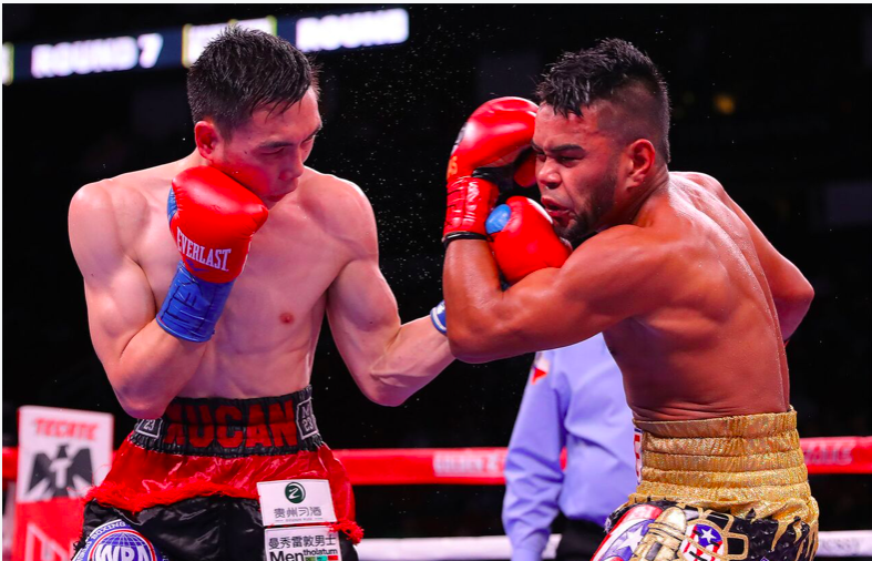 Can downed Rojas and won a title after throwing 1,245 punches in Houston.