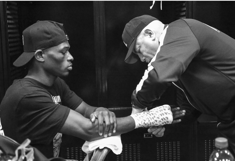 Richard Commey gets his hands wrapped by Gary Stark Sr.  Pic by Mikey Willaims