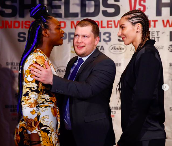 Shields stares at Hammer while promoter Salita makes peace.