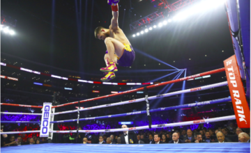 Lomachenko celebrates after demolishing Crolla.