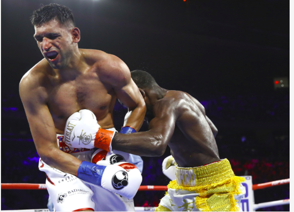 Theater of the unexpected strikes again at MSG on Saturday night. In round five, a left hook by Terence Crawford hit Amir Khan in the groin, in the main event of an ESPN PPV. He indicated he didn't want to continue, so the fight, promted by Bob Arum's Top Rank, was halted and Crawford declared the victor, because Khan quit. I know, weird....One would think that because the fight ended off a foul, a low blow, even though it was not deemed intentional, that we'd go to the cards. But no...Crawford gets the win, in strange fashion. The USA chants were countered by Khan chants as round one kicked off. We saw Bud as usual be patient. Khan fired a right to the body, and Bud looked so chill, sent Khan down. A right hand, bang, on his butt. He got up, was worried. They traded hard and nasty to end the round. A right hand on the chin buzzed Khan badly. The left hook just tipped him over. Great first round... In the second, Khan didn't enage as much. He would, and he'd flurry, and square up. To the third, we saw Bud as lefty, and things had settled from the frenetic first. Trainer Virgil Hunter had told Khan to work smarter, not harder. In the fourth, lefty Bud was patient. He stuck out his tongue, caught Khan, went righty, caught him again. Big Bud round, though a Khan connect late got his rooters buzzing. In the fifth, lefty Bud jabbed, and Khan was getting banged around. Again, a late Khan connect, this time a right lead, gave his boosters hope. To round six...we saw get hit low. He got a break...The super slow mo showed a left hook aimed at the groin. And no mas...Khan indicates that he can't continue. A rain of boos hits the ring, as the 14,091 in the joint make their displeasure known. They wanted a conclusive ending, not this bizarro ending off a foul.