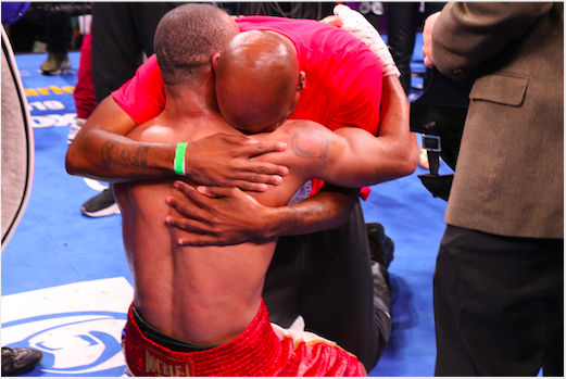 Trainer and fighter show their exuberance and bond. Julian Williams and Stephen Edwards in Leo Wilson pic.
