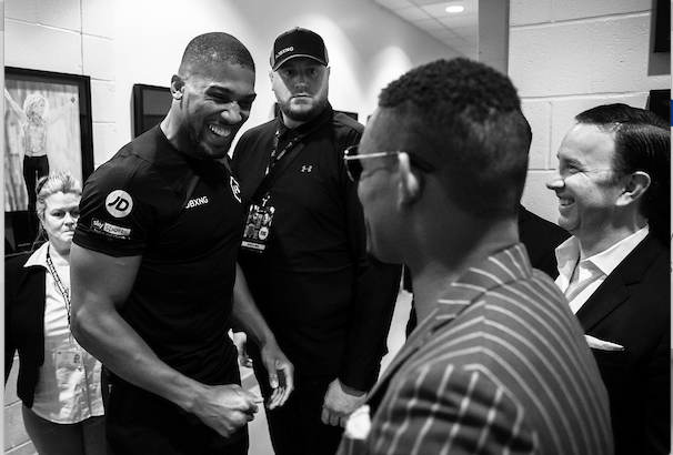 Ed Mulholland snapped this pic, of a loose AJ in his dressing room greeting Danny Jacobs.