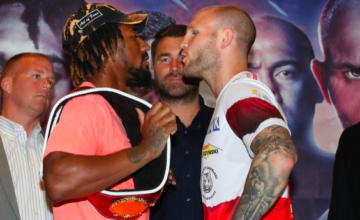 Andrade stares down with Sulecki.
