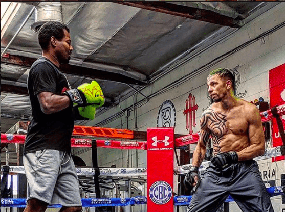 Redkach doing work with SHANE MOSLEY, learning tricks of the trade.