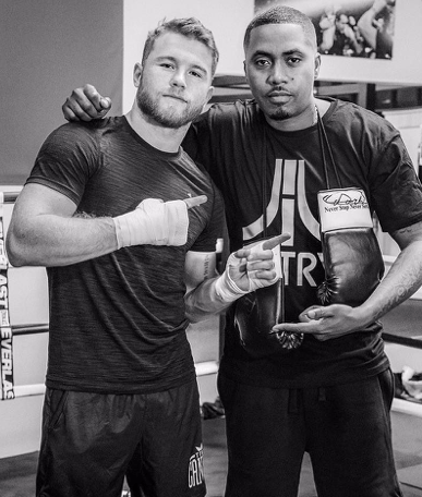 Canelo poses with entertainer Nas.