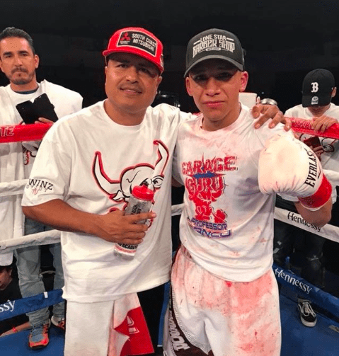 Robert Garcia poses post-win with fighter Joshua Franco.
