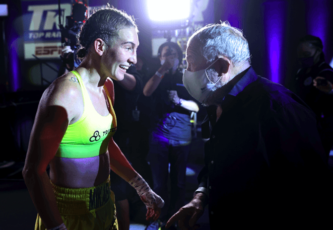 Mikaela Mayer gets congratulated by promoter Bob Arum on July 14, 2020.