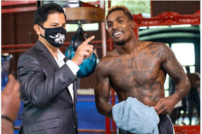 Ray Flores poses with Jermall Charlo during a fighter workout for media held Sept. 14, 2020 in Texas.