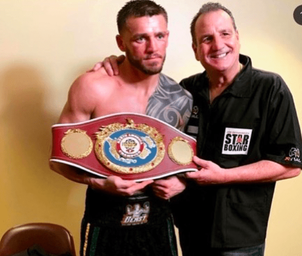 Joe Smith poses with trainer Jerry Capobianco.