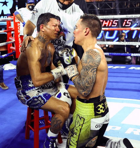 Oscar Valdez and Miguel Berchelt give each other respect after Valdez scores a stoppage in round ten.