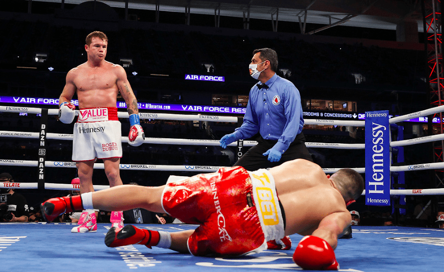 Canelo Alvarez looks at a downed Avni Yildirim in round three of their Feb. 27, 2021 super middleweight clash.