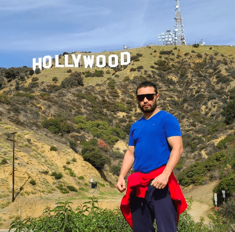 """Sergey Lipinets poses in front of the famous """"Hollywood"""" sign in CA."""