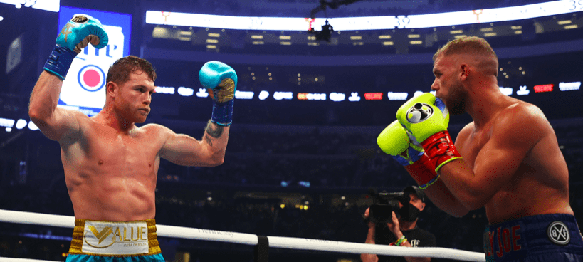 Canelo raises his arms to indicate his superiority over Billy Joe Saunders.