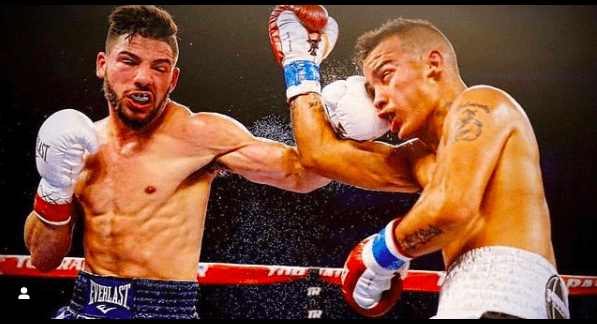 Julian Rodriguez connects on a foe, one of the 21 opponents he's bested in the pros.