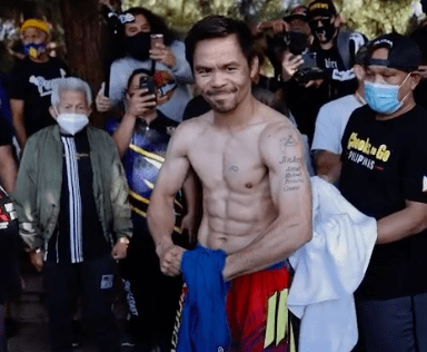 Manny Pacquiao flexes during training.