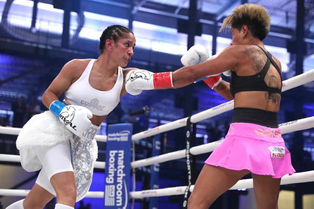 Amanda Serrano (left) would have the same knockout percentage as George Foremann if George fought two minute rounds his entire career. Photo Ed Mulholland, Matchroom Boxing USA