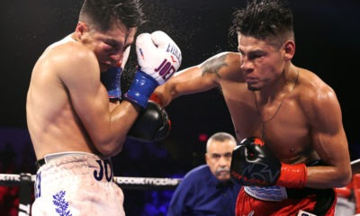 Joet Gonzalez (L) and Emanuel Navarrete (R) exchange punches during their fight for the WBO featherweight championship at Pechanga Arena on October 15, 2021 in San Diego. Photo: Mikey Williams/Top Rank Inc via Getty Images Navarrete defeats Gonzalez
